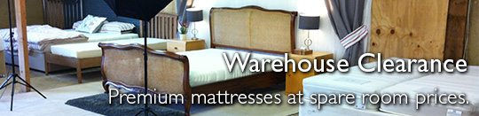 Warehouse Clearance - Premium mattresses at spare room prices.